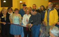 Robert Marcum cuts the ceremonial ribbon, surrounded by Pacific Grovians