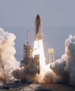 The space shuttle Discovery lifts off from Launch Pad 39B at the Kennedy Space Center at Cape Canaveral, Fla. on Tuesday, July 26, 2005. (AP Photo/Terry Renna)