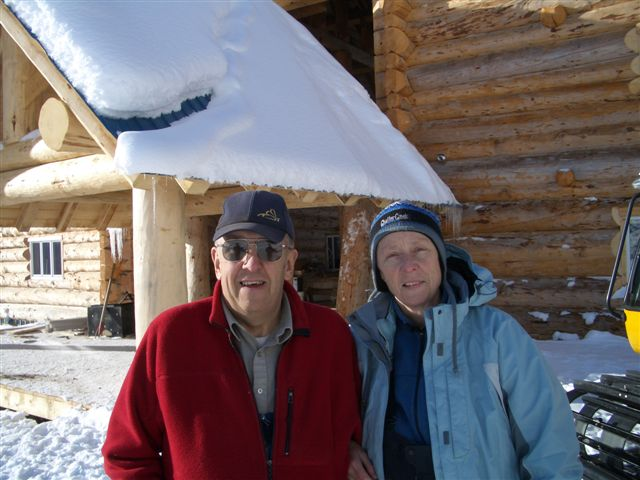 Mike McKnight and Merle in front of Vertebrae and Solitude Lodges.