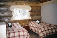 Guest bedroon in Chatter Creek's Solitude Lodge