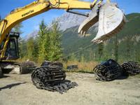 Rolling snowcat treads for summer storage at Chatter Creek