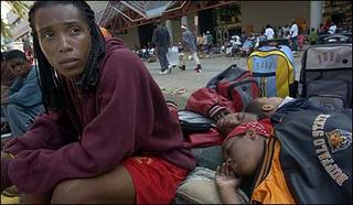 Children sleeping on side-walk outside Ernest N. Morial Convention Center in New Orleans