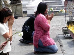 Praying in Wat Phra Kaew Bangkok Thailand