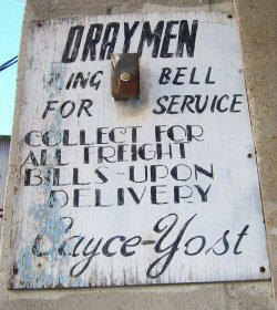 Old painted sign at delivery door, Hopkinsville, KY