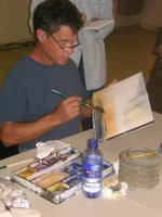 Artist David Drummond demonstrating wet in wet technique to workshop at Lake Powell October 2006