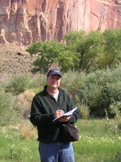 Roland Lee sketching on location in Capitol Reef National Park in preparation for a watercolor painting of Capitol Reef