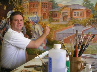 Roland Lee at work on an oil painting