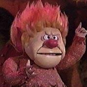 I'm Mister Green Christmas. I'm Mister Sun. I'm Mister Heat Blister. I'm Mister Hundred and One! They call me Heat Miser, What ever I touch starts to melt in my clutch I'm too much!