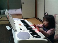 my daughter and her piano