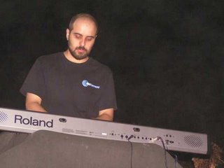 Stupid geek in a BitTorrent t-shirt plays piano