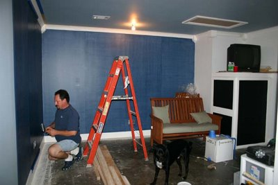 Check out the black chalkboards (on the right below the tv) I painted this week