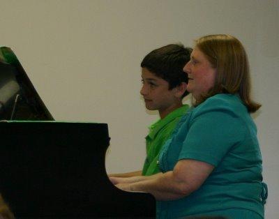 Matthew and his piano teacher
