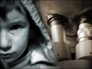 Image of a child next to a man looking into a microscope