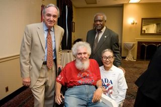 Image of Four People at AAPD 16th Anniversary of Americans with Disabilities Act