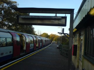 A Northern Line train waits to depart from Mill Hill East station
