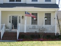 US Flag hanging outside a home