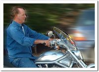 Michael Barrymore riding a Harley-Davidson motorbike