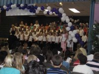 The fifth grade choir sing