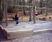 Emily & Lauren on the swings at Lake Tomahawk