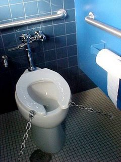 Toilet with its seat chained to the floor
