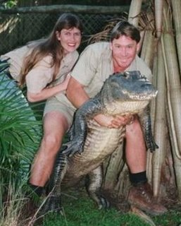 Steve Irwin with wife Terri holding a cocodile