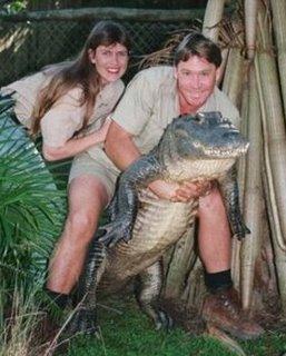 Steve Irwin with wife Terri holding a cocodile