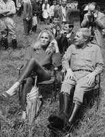 Ursula and Marcello relax on the set