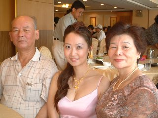 Beautiful wife and relatives at wedding dinner