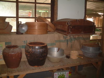Antique rice steamer, jars, and cooking utensils