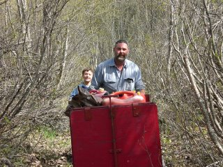Dave and Ray with the power carrier, a motorized cart on tracks