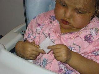 Sasha sterilizes a PICC lumen with an alcohol wipe
