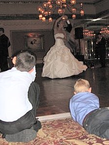 Christopher and Brennan watch Julie and Nick take their first dance together.
