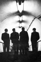 Joy Division in the tube (it's slang for subway...dork)