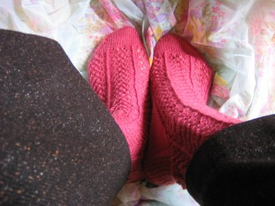 pink hedera socks on flower fabric