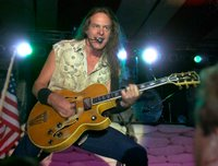 ted nugent playing on a gibson byrdland guitar