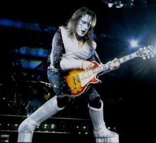 ace frehley playing a gibson les paul