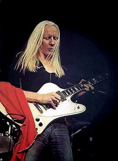 johnny winter playing on a gibson firebird