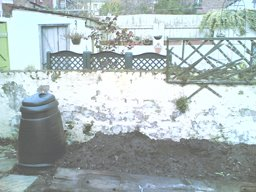 Compost bin and wall where the Cat Proof Fence is going