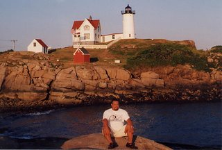 James Audiffred poses in front of one of the many lighthouses he loved to research