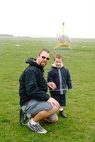 TJ and I in front of the helicopter that took us over the Twelve Apostles