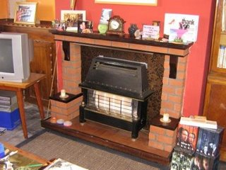 Photo by Rullsenberg: dining room fireplace 1970s bricks