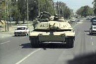 US Soldiers on patrol in a tank on Baghdad streets.