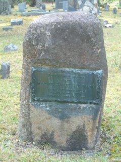 Shot of large rock grave marker.