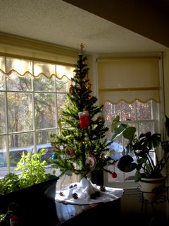This is the smaller faux tree from Japan that is sitting in our bay window on the buffet in our dining room.