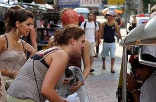 Calling for Tuktuk in Khaosarn Road Bangkok Thailand