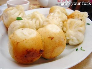 Pan-fried pork buns with crispy bottoms showing