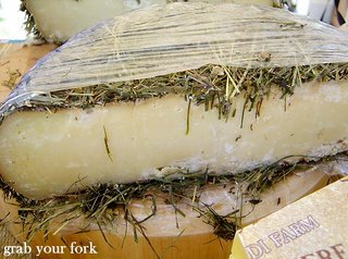 cheese covered with hay