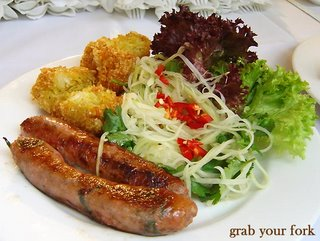 thai style pork sausages on a plate