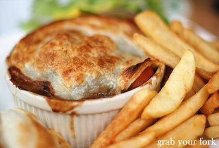 beef and Guinness pie with chips closeup