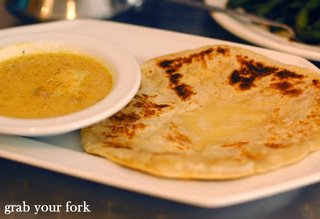 Roti canai flatbread with curry sauce